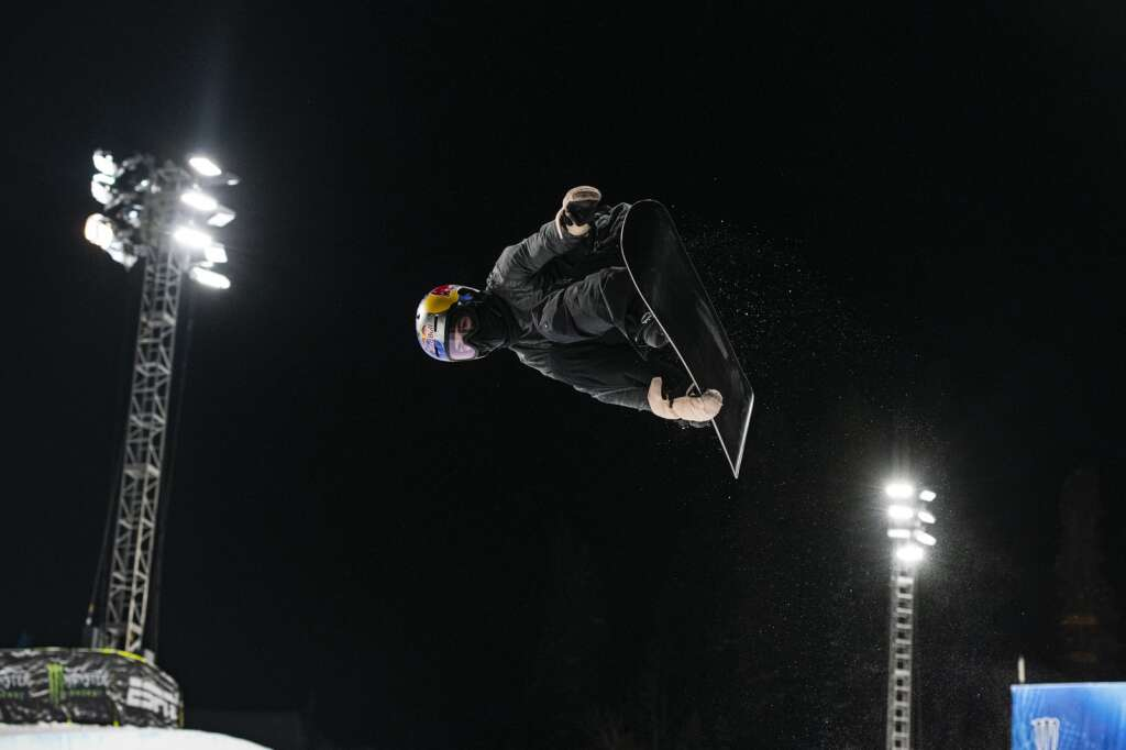 American snowboarder Toby Miller airs out of the Buttermilk Superpipe on the first evening of practice for the 2021 X Games Aspen on Tuesday, Jan. 26, 2021.