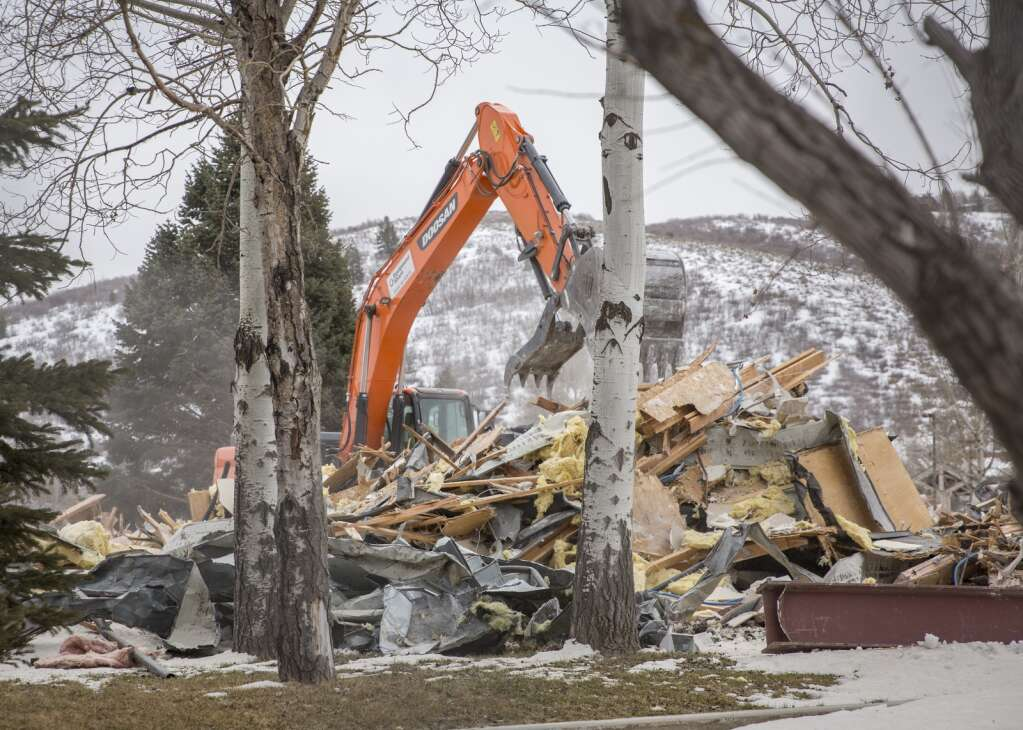 An excavator clears debris from the former Intermountain Healthcare building demolition during the first stages of the new Arts & Culture District development plan Monday afternoon, March 29, 2021. (Tanzi Propst/Park Record)