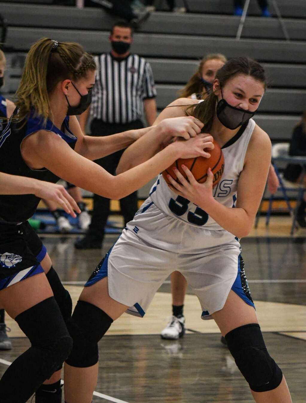 Coal Ridge Titan Taylor Wiescamp fights to keep possession of the ball during Tuesday night's game against the Moffat County Bulldogs. | Chelsea Self / Post Independent