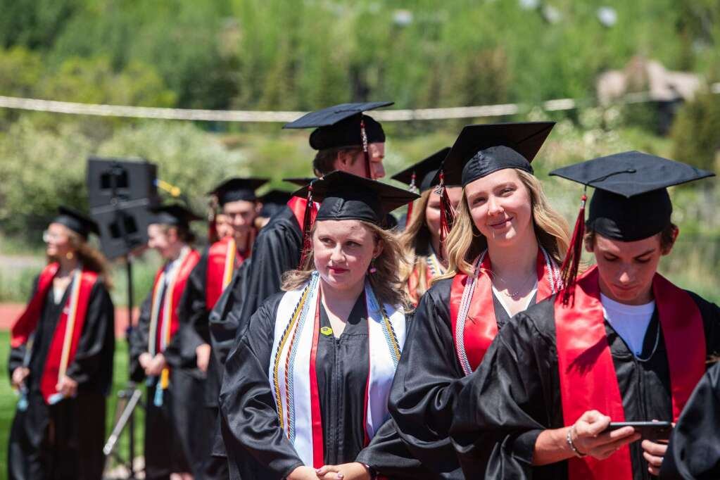 Aspen High School graduates wait in line to cross the stage during the commencement ceremony on Saturday, June 5, 2021. (Kelsey Brunner/The Aspen Times)