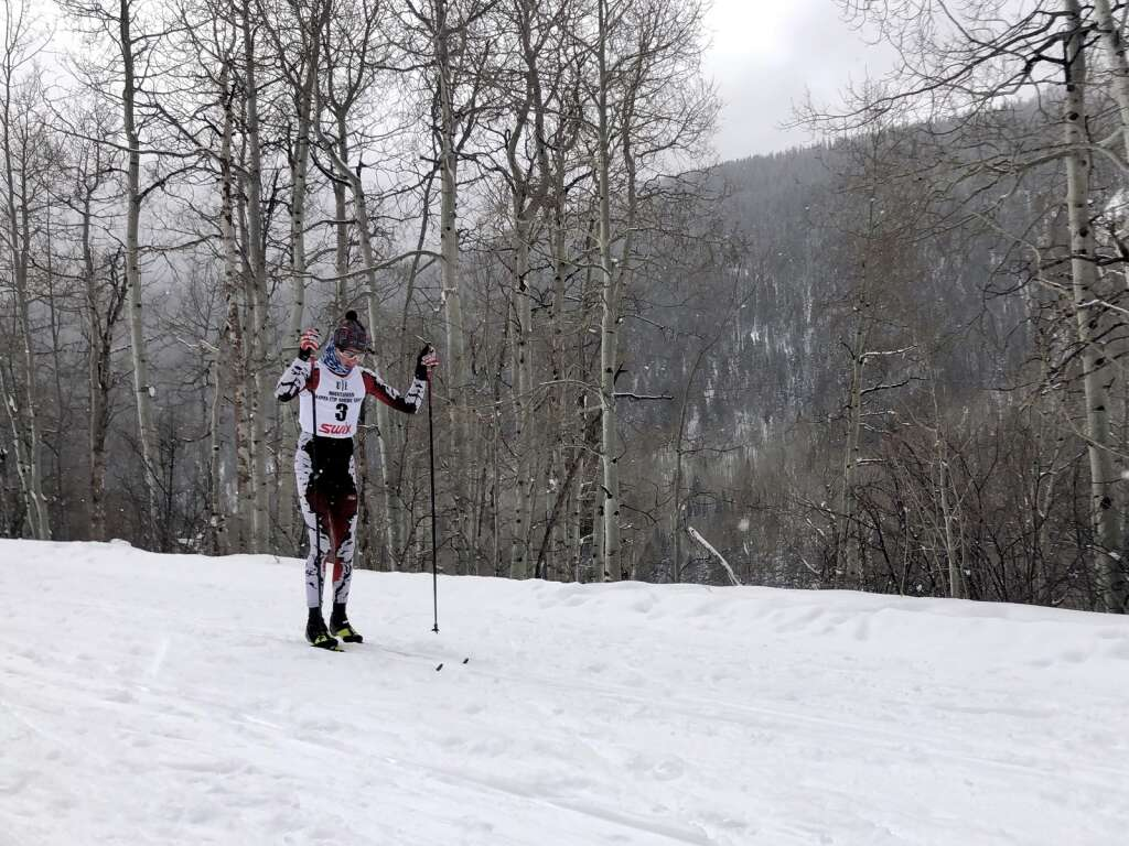 Eske Roennau double-poles on the descent after completing the