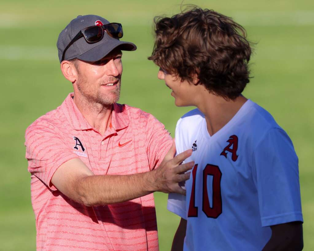Aspen High School boys soccer coach Dave Francis chats with player Andrew Bass after their 8-1 win over Basalt on Wednesday, Sept. 15, 2021, on the BHS field. | Photo by Austin Colbert/The Aspen Times