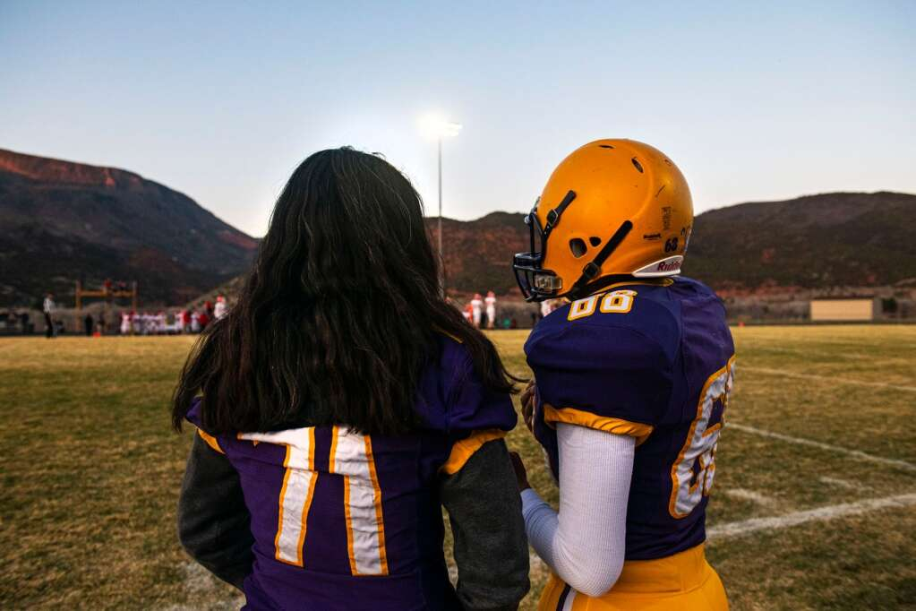 Twins Katie, left, and Chandra Bohannan stand on the sidelines during the game against Glenwood High School on senior night at Basalt on Friday, April 9, 2021. (Kelsey Brunner/The Aspen Times)