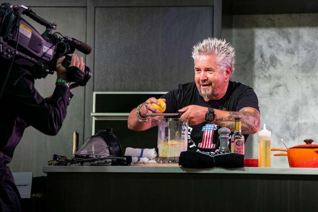 Guy Fieri jokes with the cameraman while teaching the audience of his morning seminar the secret to properly zesting a lemon at the Food & Wine Classic in Aspen on Saturday, Sept. 11, 2021. (Kelsey Brunner/The Aspen Times)