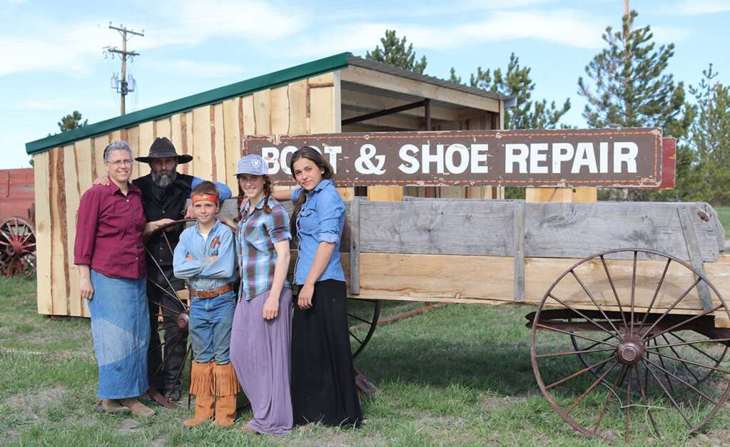 Jerry Foerderer and his family recently opened the Village Barn in Harrison, a boot, shoe and saddle repair shop that also offers custom leatherwork and antiques. He's pictured here with wife Laurie, and three of their seven children, Cameron, 10, Cailey, 16, and Cara, 14.