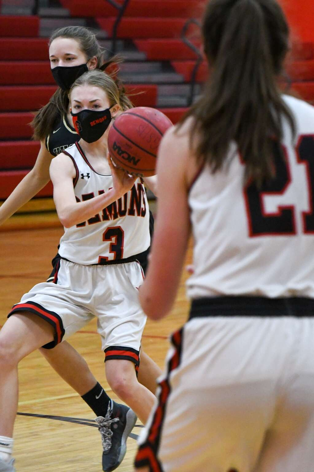 Glenwood Springs High School Demon Ella Johnson passes the ball to an open teammate during Thursday night's game against the Battle Mountain Huskies. |Chelsea Self / Post Independent