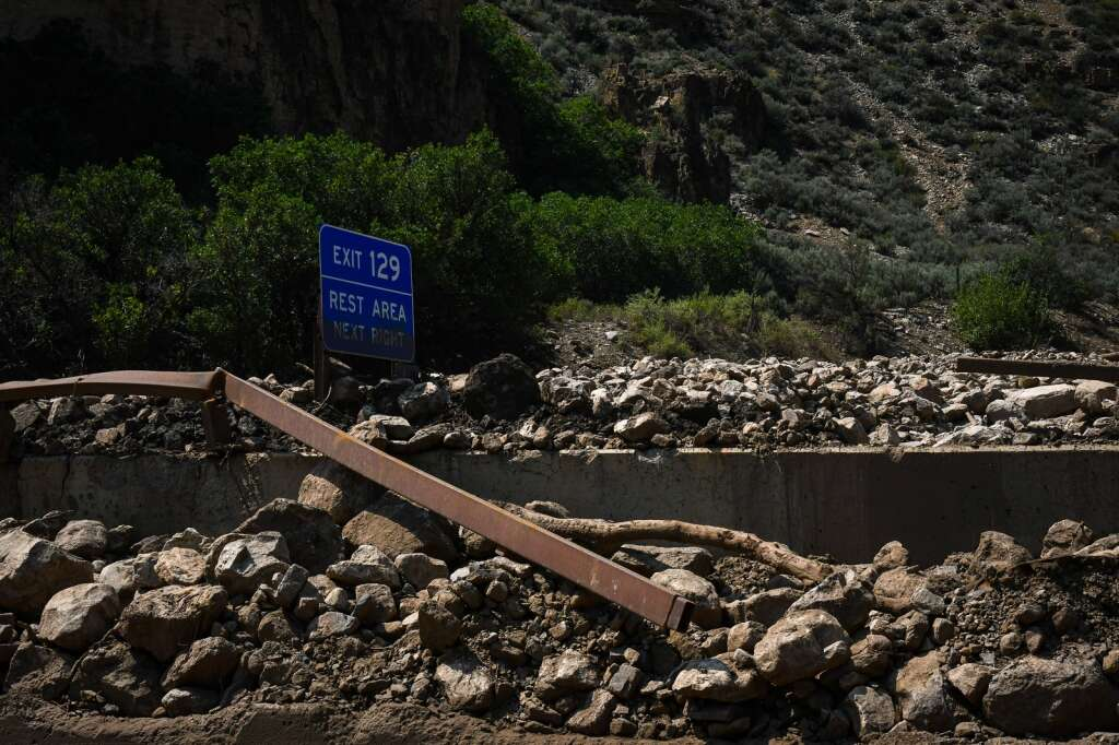 Rocks and debris pile multiple feet high in a drainage and between the east and westbound decks in Glenwood Canyon near Bair Ranch. MM 129. |Chelsea Self / Post Independent