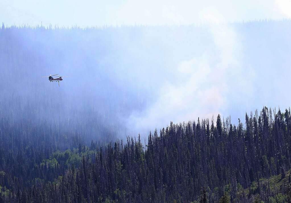 A helicopter drops water on the Muddy Slide Fire on June 21. (Photo by John F. Russell)
