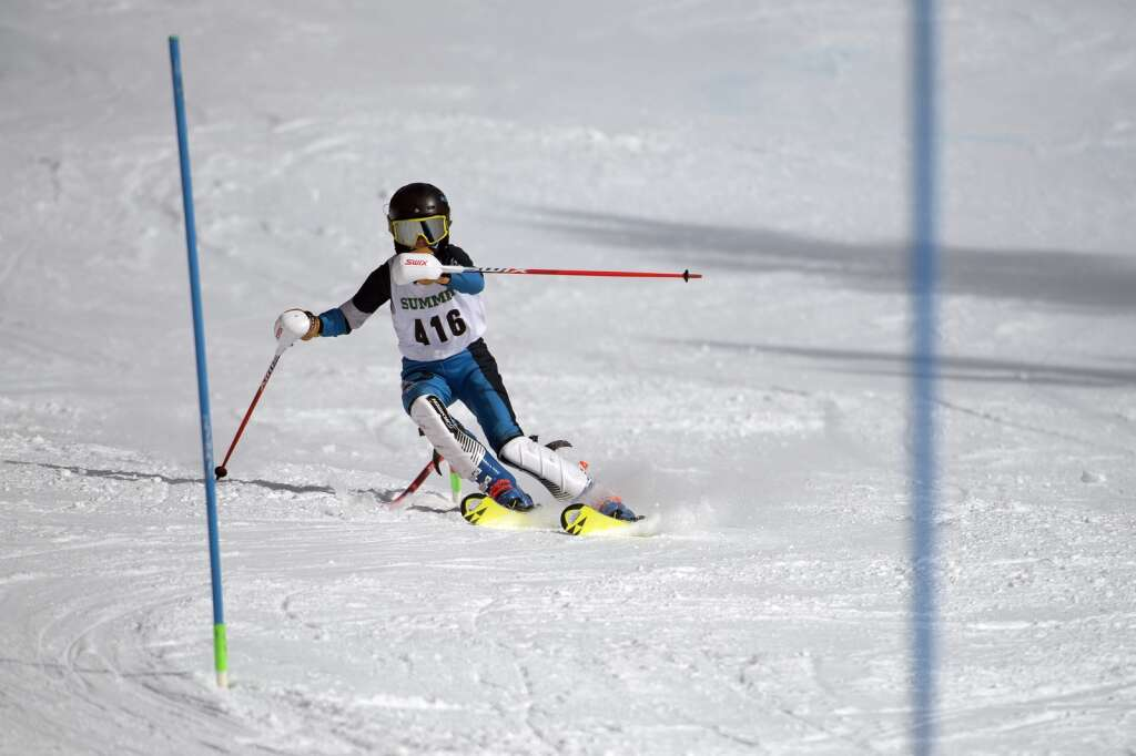 Summit High School Alpine ski team racer Wyatt Huston navigates gates while skiing the slalom course during the Colorado High School State Alpine Ski Championships at Loveland Valley Ski Area on Thursday, March 11, 2021. | Photo by Jason Connolly / Jason Connolly Photography