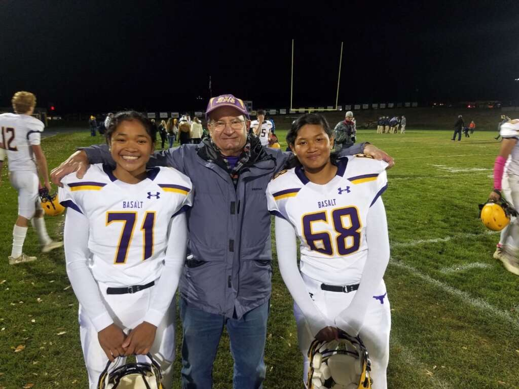 Katie, left, and Chandra, right, pose with father Rick Bohannan after a game. The twins have had quite the storied career at Basalt High School. The seniors were a key part of a breakthrough girls basketball team this winter and Chandra is in her fourth season on the football team, while Katie remains on as the team manager. Courtesy photo.