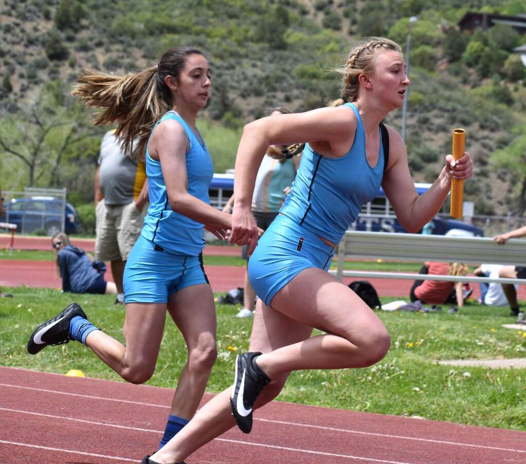 The Coal Ridge girls 4x100 relay makes the final exchange en route to the event win Saturday.| John Stroud/Post Independent