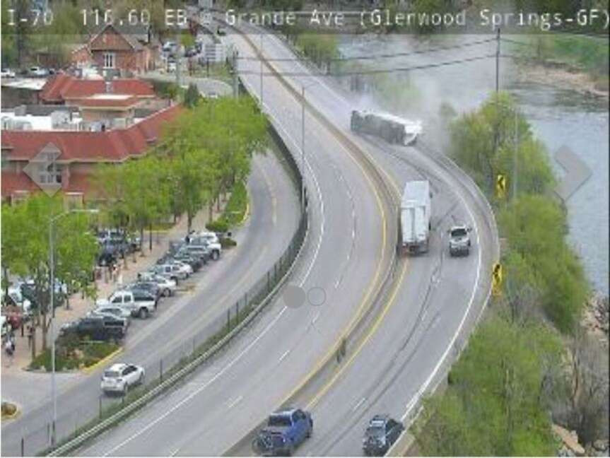 Interstate 70 surveillance video still shot of the May 15, 2021 semi tractor-trailer rollover just east of the main Glenwood Springs Exit 116, near the Hot Springs Pool. | CDOT photo