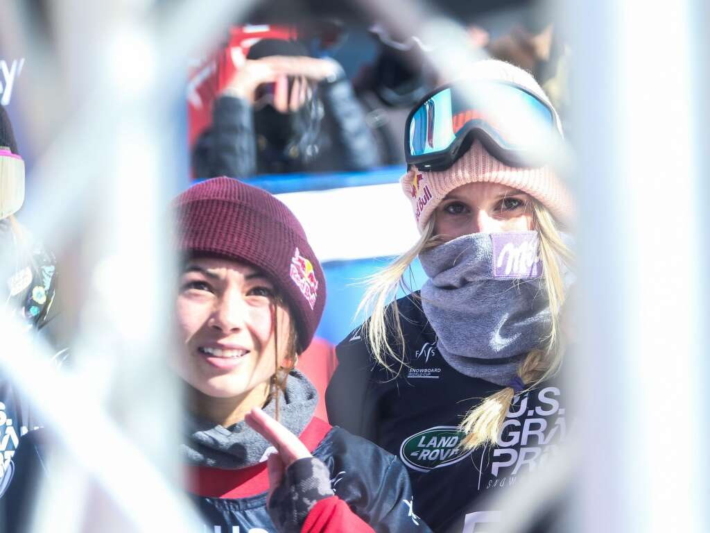 Hailey Langland, left, and Anna Gasser watch the final riders on the monitor during the women's snowboard slopestyle contest of the U.S. Grand Prix and World Cup on Saturday, March 20, 2021, at Buttermilk Ski Area in Aspen. Photo by Austin Colbert/The Aspen Times.