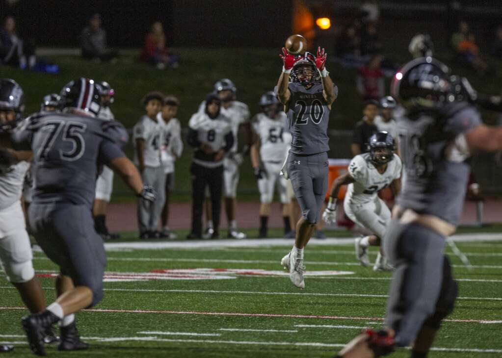 Park City High School's  Matt DeMarco (20) completes a pass from Carson Tabaracci during the Miners' homecoming matchup against Highland High School at Dozier Field Friday evening, Sept. 17, 2021. The Miners defeated the Rams 41-6. (Tanzi Propst/Park Record)