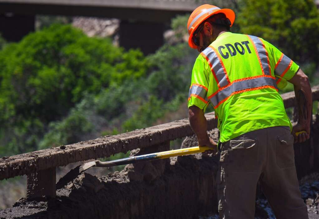 CDOT crews make progress cleaning up the lower eastbound decks of Interstate 70 on Monday near MM120 after a mudslide swept down the cliffs in Glenwood Canyon in the area of the Grizzly Creek burn scar on Sunday. |Chelsea Self / Post Independent