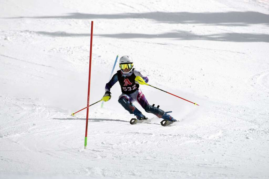 Aspen High School Alpine ski team racer Maddy Hicks navigates gates while skiing the slalom course during the Colorado High School State Alpine Ski Championships at Loveland Ski Area on Friday, March 12, 2021.   Photo by Jason Connolly / Jason Connolly Photography