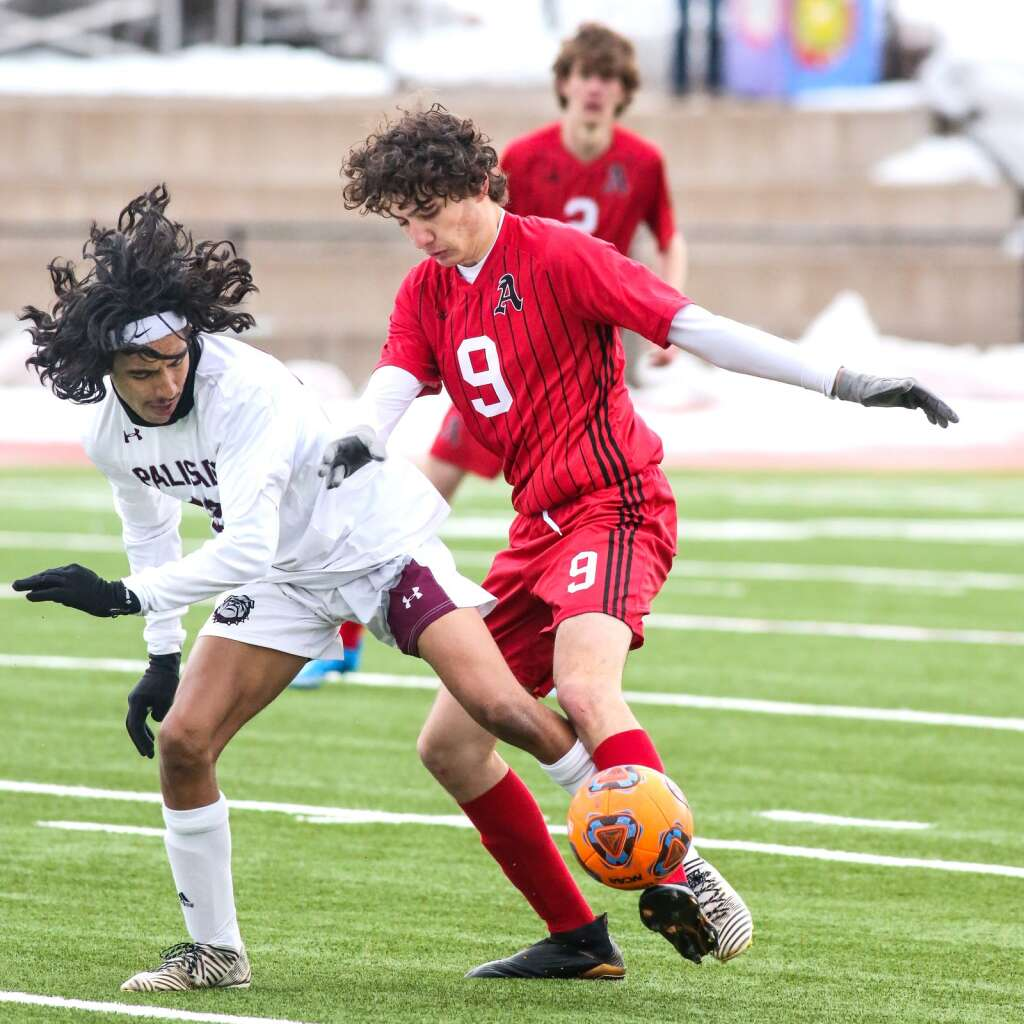 Aspen High School boys soccer player Charlie Forster battles for the ball against Palisade on Thursday, March 25, 2021, on the AHS turf. Photo by Austin Colbert/The Aspen Times.