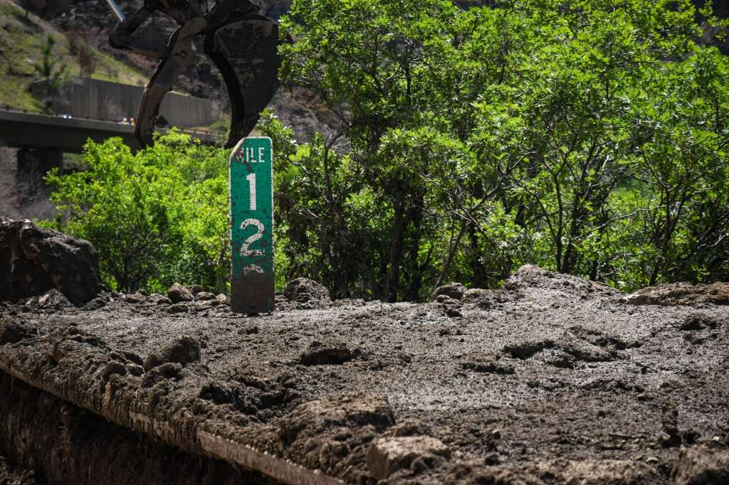 Multiple feet of mud sits on the shoulder of the eastbound deck of Interstate 70 at MM120  after a mudslide swept down the cliffs in Glenwood Canyon in the area of the Grizzly Creek burn scar on Sunday. |Chelsea Self / Post Independent