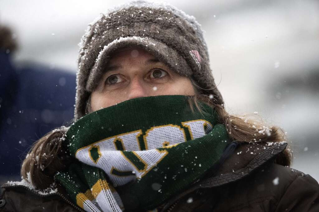 Tiger fan Patti Callahan is bundled up while watching the Summit High boys varsity match against Glenwood Springs Demons during a snowy senior night at Climax Molybdenum Field at Tiger Stadium on April 15, 2021. The Tigers defeated the Demons 4-0. | Photo by Jason Connolly / Jason Connolly Photography