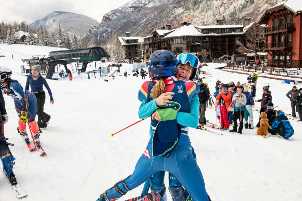 American alpine skier Resi Stiegler, right, embraces Annaliese Fleck after Fleck's second run at the Women's Slalom National Championships at Aspen Highlands on Friday, April 16, 2021. (Kelsey Brunner/The Aspen Times)