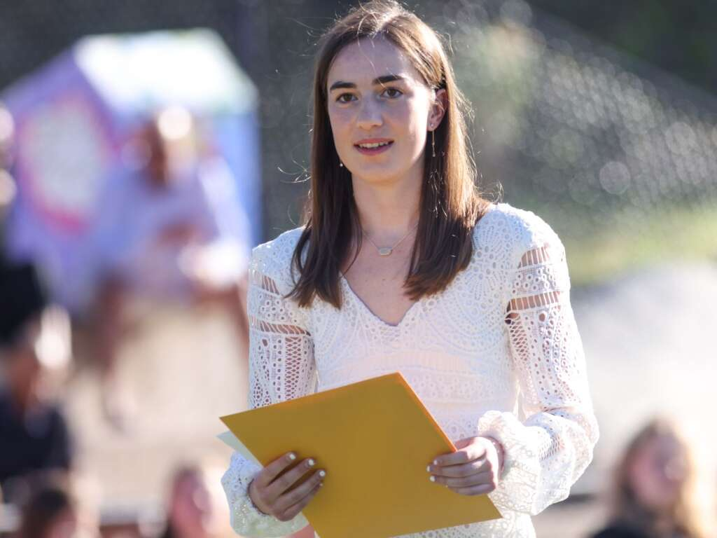 Macy Hopkinson receives her scholarship during the Aspen High School senior awards and local scholarship ceremony on Monday, May 24, 2021, on the AHS turf field. Photo by Austin Colbert/The Aspen Times.
