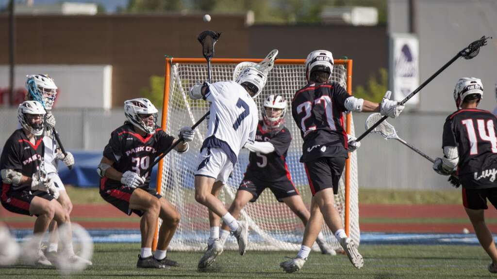 Corner Canyon High School junior Mason Quick (7) shoots for the Chargers, scoring another goal. (Tanzi Propst/Park Record)