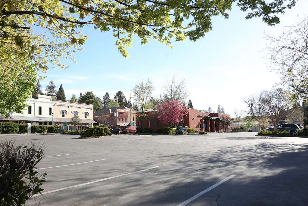 Downtown Grass Valley's City Hall parking lot sits empty after the initial Covid-19 shutdowns in March. | Photo: Elias Funez