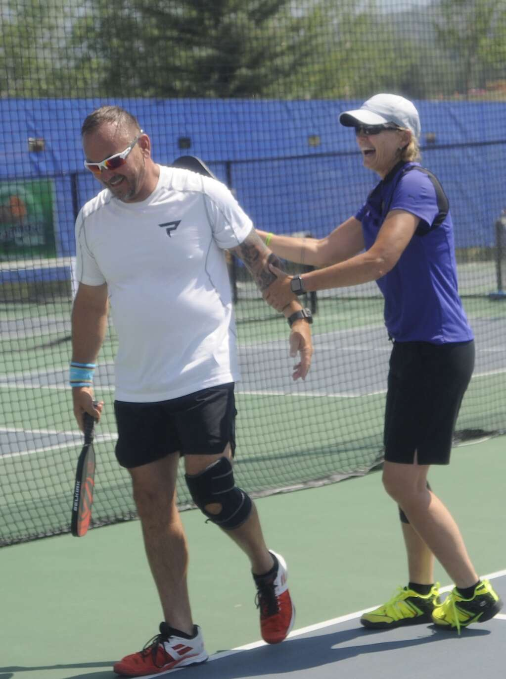 Gio Giovetti and Kevin Wesolowski celebrate a win at the Steamboat Classic Pickleball Tournament on Saturday afternoon. (Photo by Shelby Reardon)