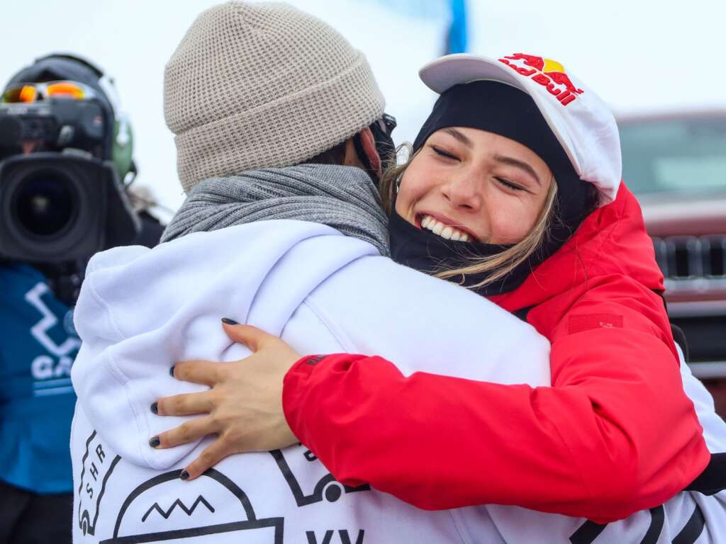 Eileen Gu hugs her coach, Brad Prosser, after winning the women's ski slopestyle contest at X Games Aspen on Saturday, Jan. 30, 2021, at Buttermilk Ski Area. Photo by Austin Colbert/The Aspen Times.