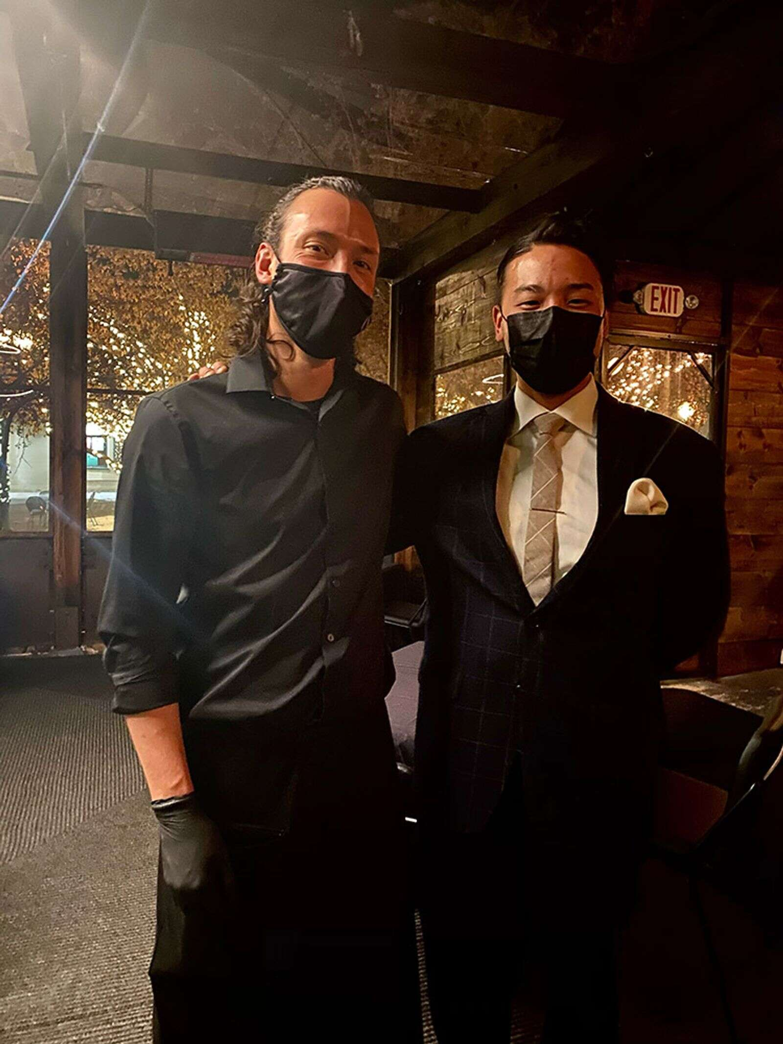 Sushi Nakazawa server JonPaul Ferzacca with general manager Shota Nishimura on their indoor patio.