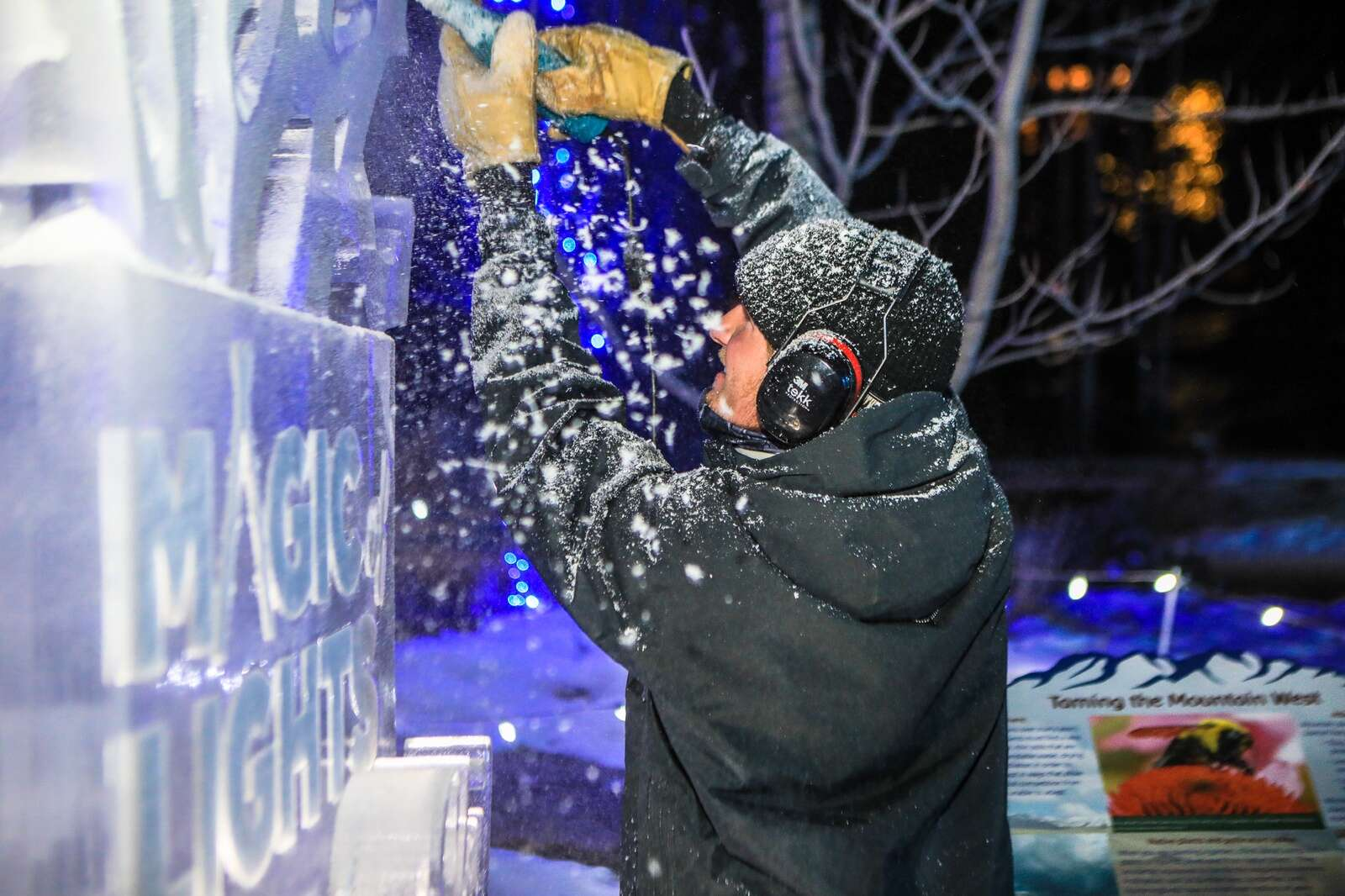 Jake Proffit of Alpine Ice carves an ice sculpture for the Magic of Lights Vail Thursday in Vail. The events features half-a-million lights throughout a half-mile walk through Betty Ford Alpine Gardens in Vail. (Chris Dillmann/cdillmann@vaildaily.com)