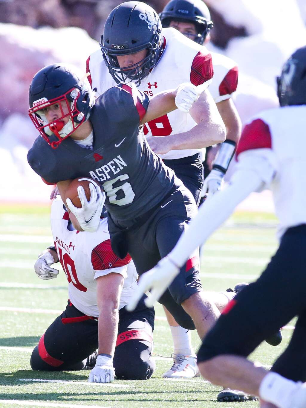 Aspen High School's Storm Silich runs with the ball against Steamboat Springs on Saturday, April 10, 2021, on the AHS turf. The Skiers won, 22-7. Photo by Austin Colbert/The Aspen Times.
