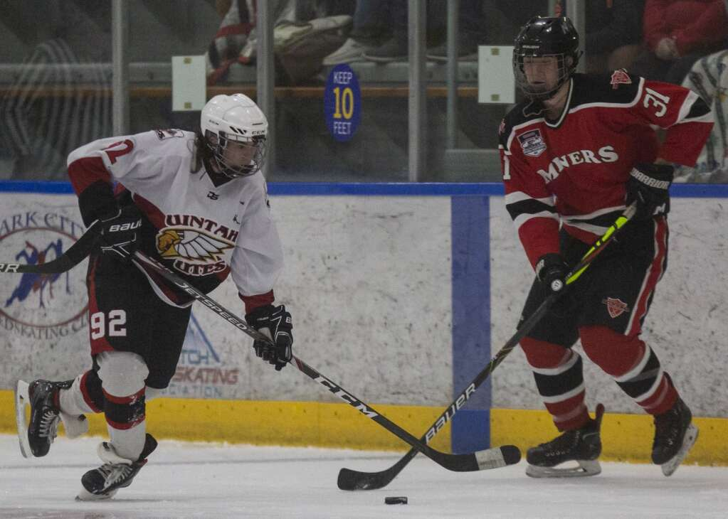 Park City High School's Micah Procino (31) fights for control of the puck during the Miners' matchup against Uintah at the Park City Ice Arena Saturday evening, Sept. 25, 2021. The Miners defeated the Utes 6-0. (Tanzi Propst/Park Record)