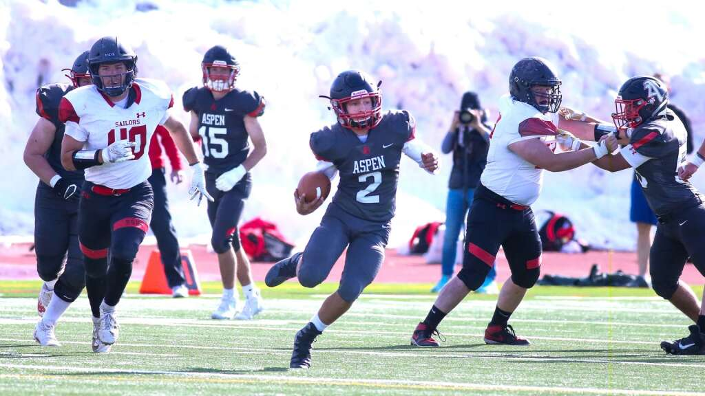 Aspen High School's Carson Clettenberg carries the ball against Steamboat Springs on Saturday, April 10, 2021, on the AHS turf. The Skiers won, 22-7. Photo by Austin Colbert/The Aspen Times.