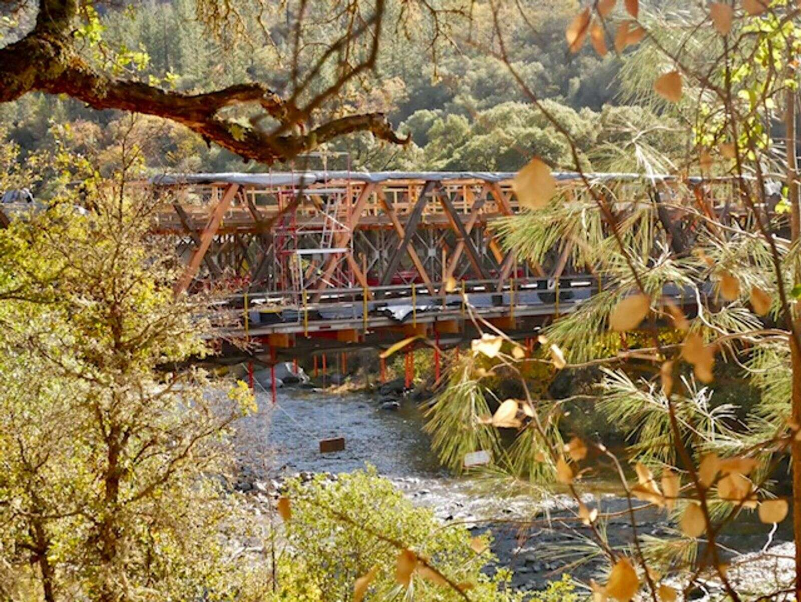 As the leaves fall, the Covered Bridge at Bridgeport continues to be rebuilt. | Submitted by Ruth Goodin