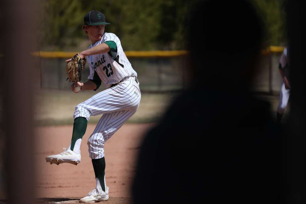 Summit High School junior Charlie Pidego pitches during the varsity baseball team season opener vs. Holy Family on May 8 at the Frisco Peninsula Recreation Area.   Photo by Ashley Low / Ashley Low Photography