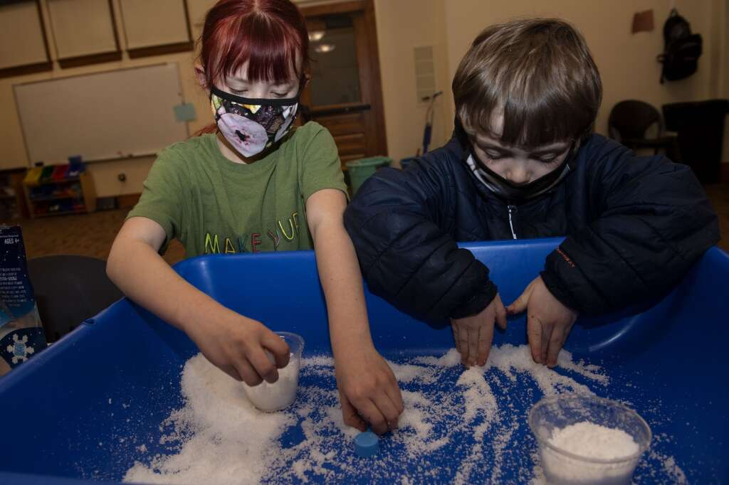 Alice Graham, left, and Emitt Wagner work on a science experiment while attending at the Mountain Top Exploratorium after-school program at the Summit County Library south branch in Breckenridge on Monday, Jan. 25.   Photo by Jason Connolly / Jason Connolly Photography