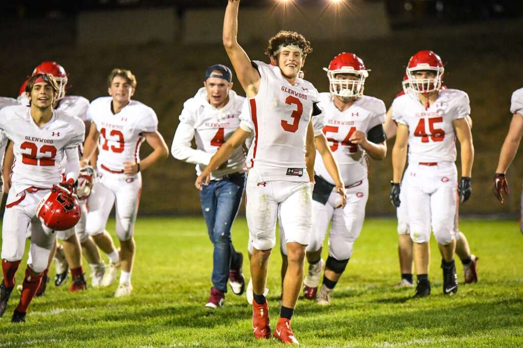 The Glenwood Springs Demons react after defeating the Rifle Bears during Friday night's rivalry game.  Chelsea Self / Post Independent