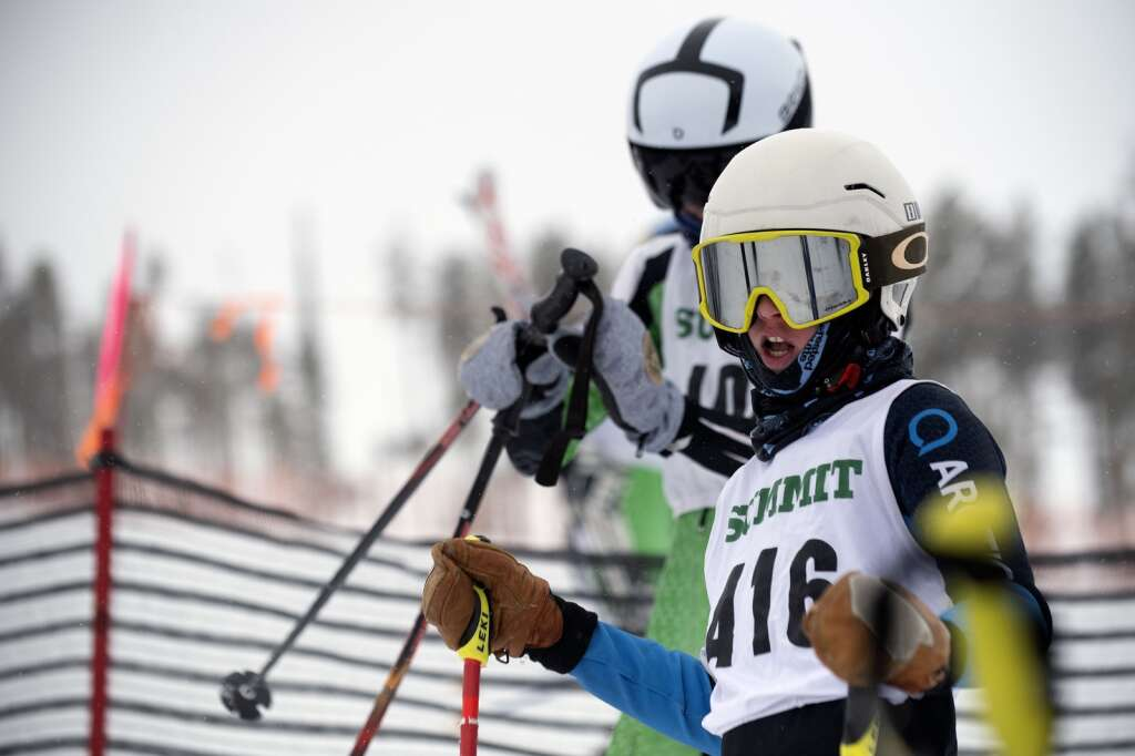 Summit High School Alpine ski team racer Wyatt Huston watches as a teammate competes in a giant slalom race during a ski competition at Keystone Resort on Friday, Feb. 5, 2021. | Photo by Jason Connolly / Jason Connolly Photography