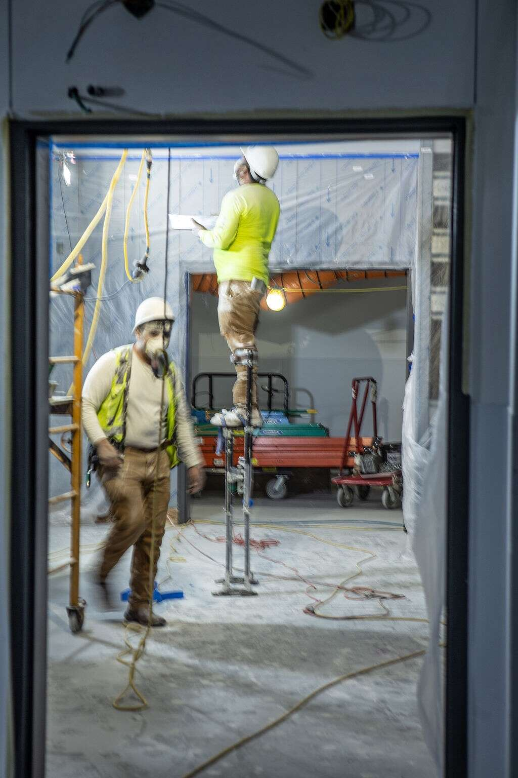 Construction crews work inside one of the operating rooms located within Vail Health's new medical center in Dillon on Friday, August 27, 2021. Once completed, the center will have four operating rooms that'll focus on orthopedic and pain management procedures.   Photo by Michael Yearout / Michael Yearout Photography