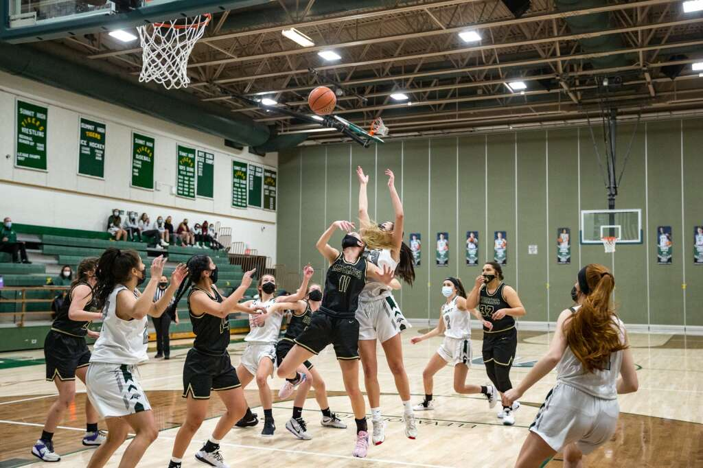 Summit's Autumn Rivera battles Mia Bettis after Anna Garvert's (No. 2) missed shot during the first period of the varsity game against Battle Mountain on Thursday, Feb. 25, at Summit High School in Breckenridge. The Tigers fell to the Huskies, 70-34. | Photo by Liz Copan / Studio Copan