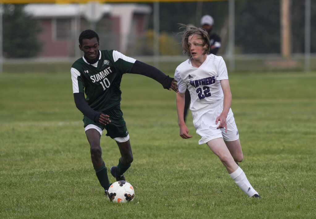 Thierno Ly (left) competes for possession of the ball during the Summit High School varsity boys soccer team's scrimmage vs. Middle Park High School on Tuesday at Middle Park. | Photo by Eli Pace / Sky-Hi News