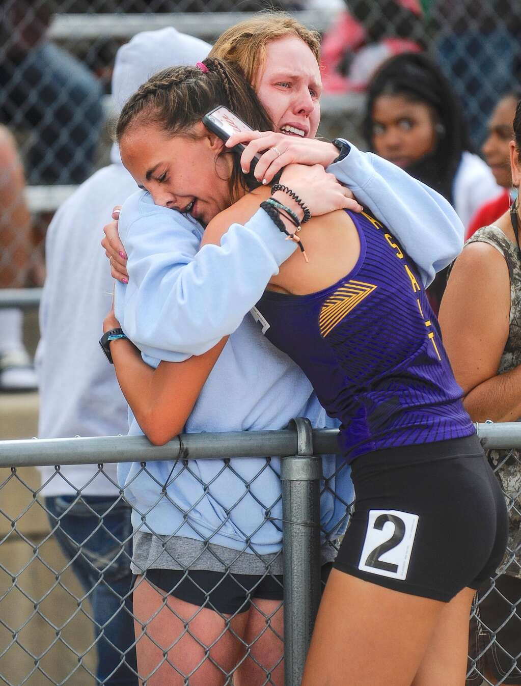 Basalt High School sophomore Katelyn Maley, right, hugs her sister, BHS graduate Megan Maley, after she won the Class 3A girls' 1,600-meter race at the state track and field championships on Saturday, June 26, 2021, at Jefferson County Stadium in Lakewood. Photo by Shelby Reardon/Steamboat Pilot & Today.