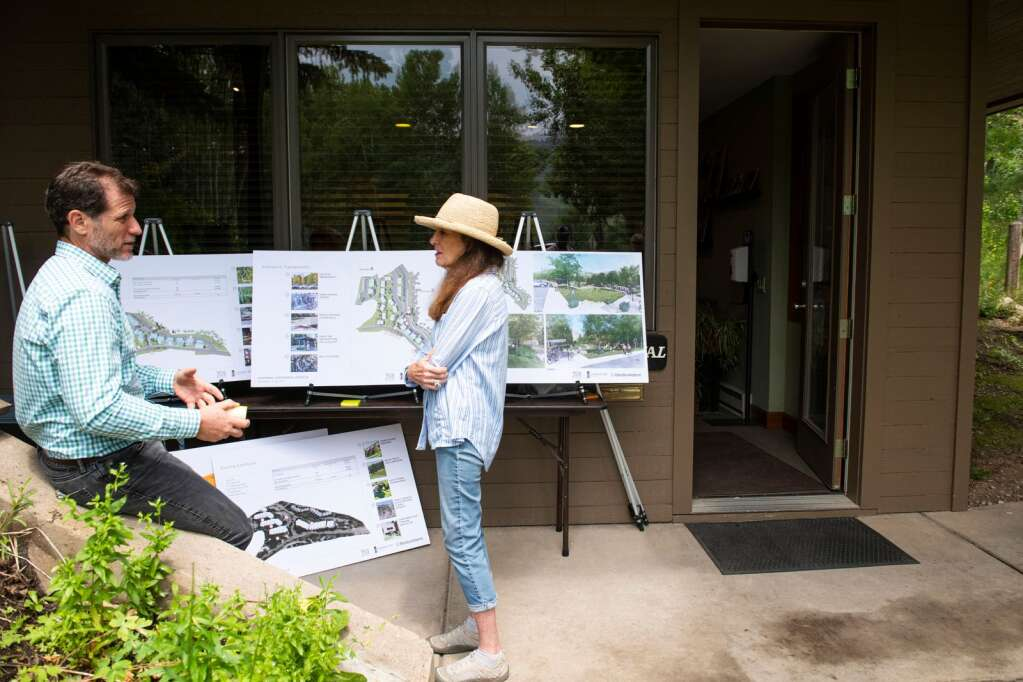 People discuss the proposed redevelopment of the Centennial rental complex on Tuesday, July 13, 2021. (Kelsey Brunner/The Aspen Times)