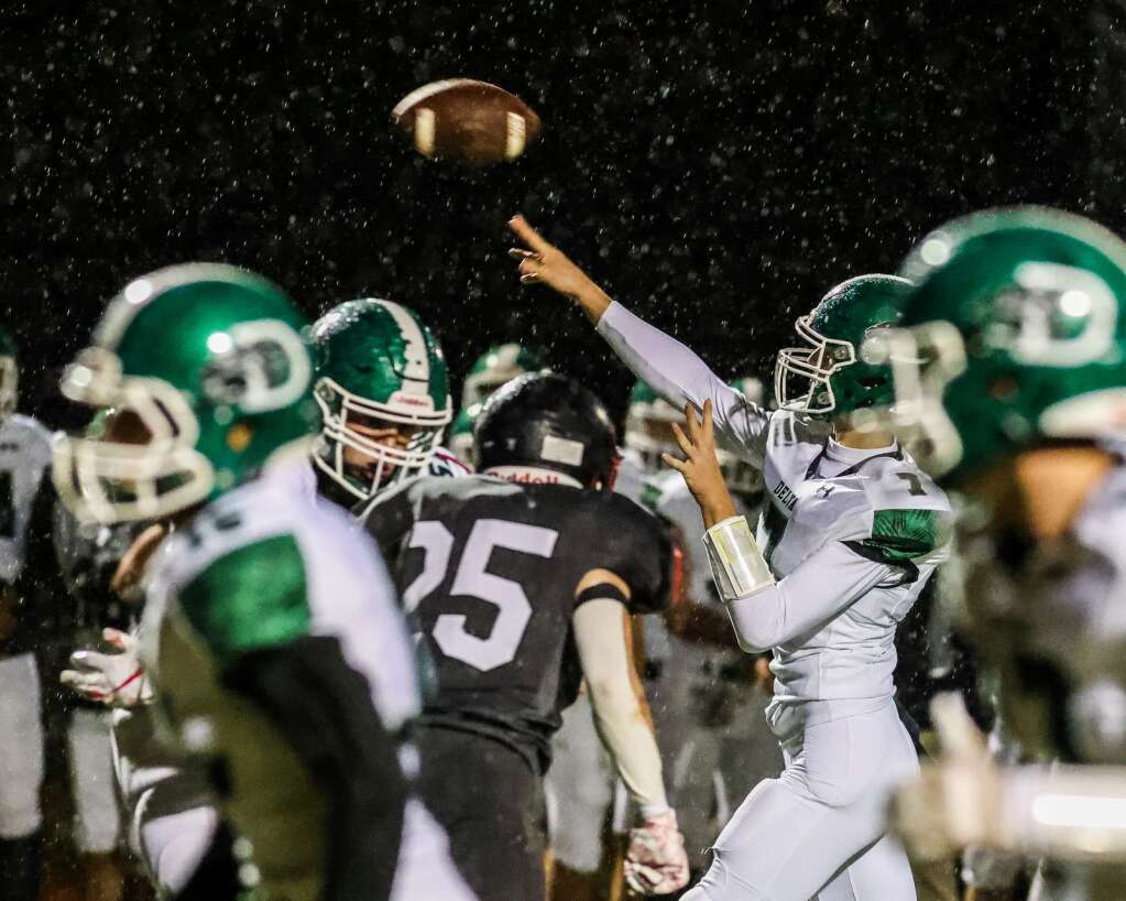 Delta quarterback Ty Reed throws against Aspen on Friday, Oct. 8, 2021, on the AHS turf. Photo by Austin Colbert/The Aspen Times.