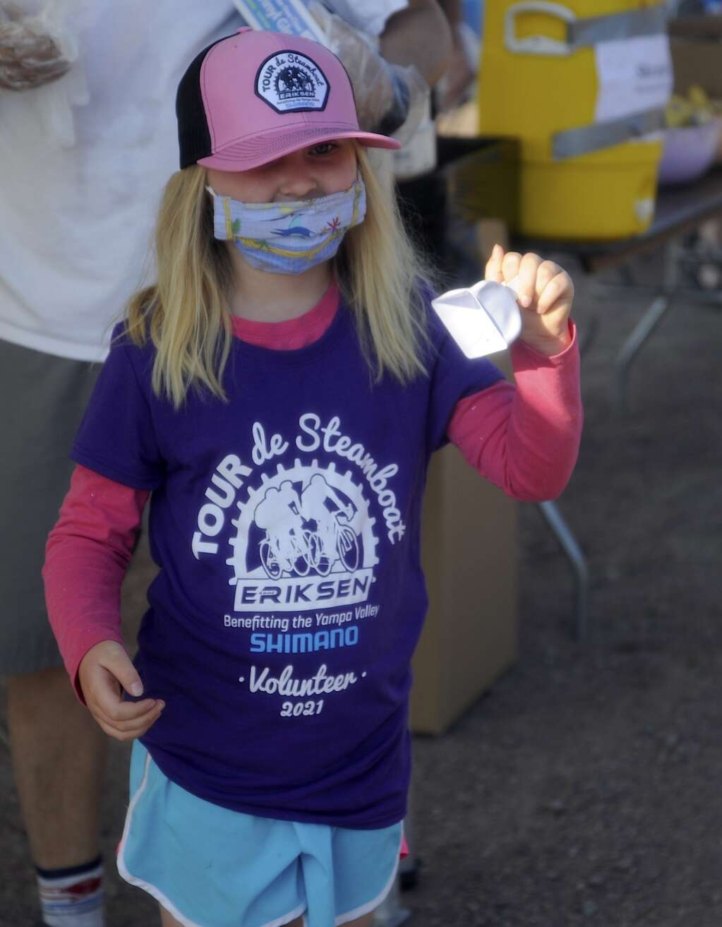 Bella Whitaker, 5, rings a cowbell to welcome cyclists at the Stagecoach aid station as part of the Tour de Steamboat Springs on Saturday. (Photo by Shelby Reardon)