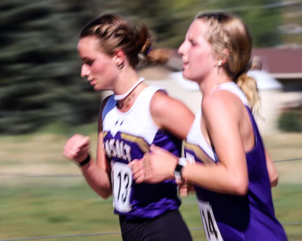Two Basalt runners compete in the Longhorn Invitational cross country meet on Saturday, Aug. 28, 2021, at Crown Mountain Park in El Jebel. Photo by Austin Colbert/The Aspen Times.