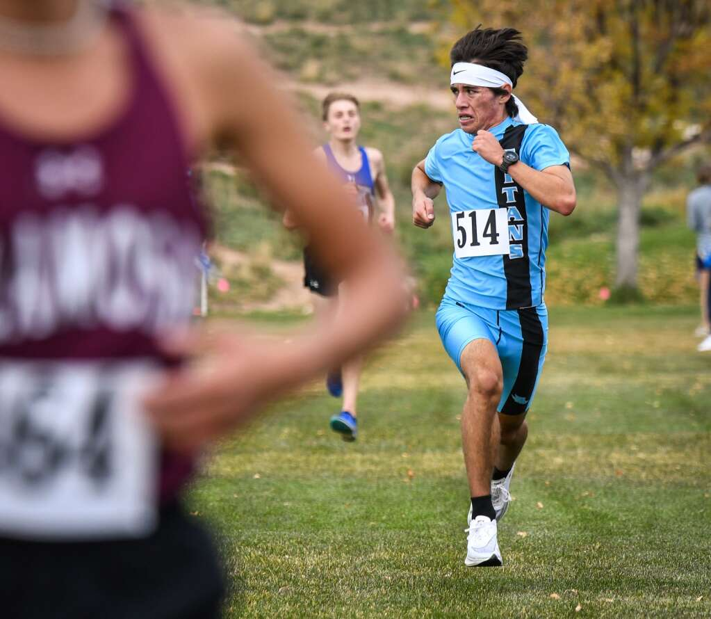 Coal Ridge High School runner Tyler Parker looks to the runner behind him while pushing it to the finish line at Friday's Colorado 3A Region 1 XC meet at VIX Park in New Castle.  Chelsea Self/Post Independent