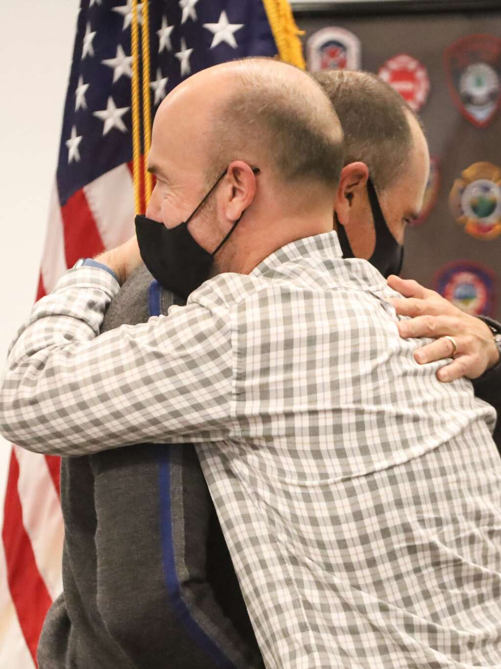 Basalt resident Michael Latousek gives a hug during a ceremony organized by Roaring Fork Fire Rescue on Friday, Feb. 12, 2021, in El Jebel. Photo by Austin Colbert/The Aspen Times.