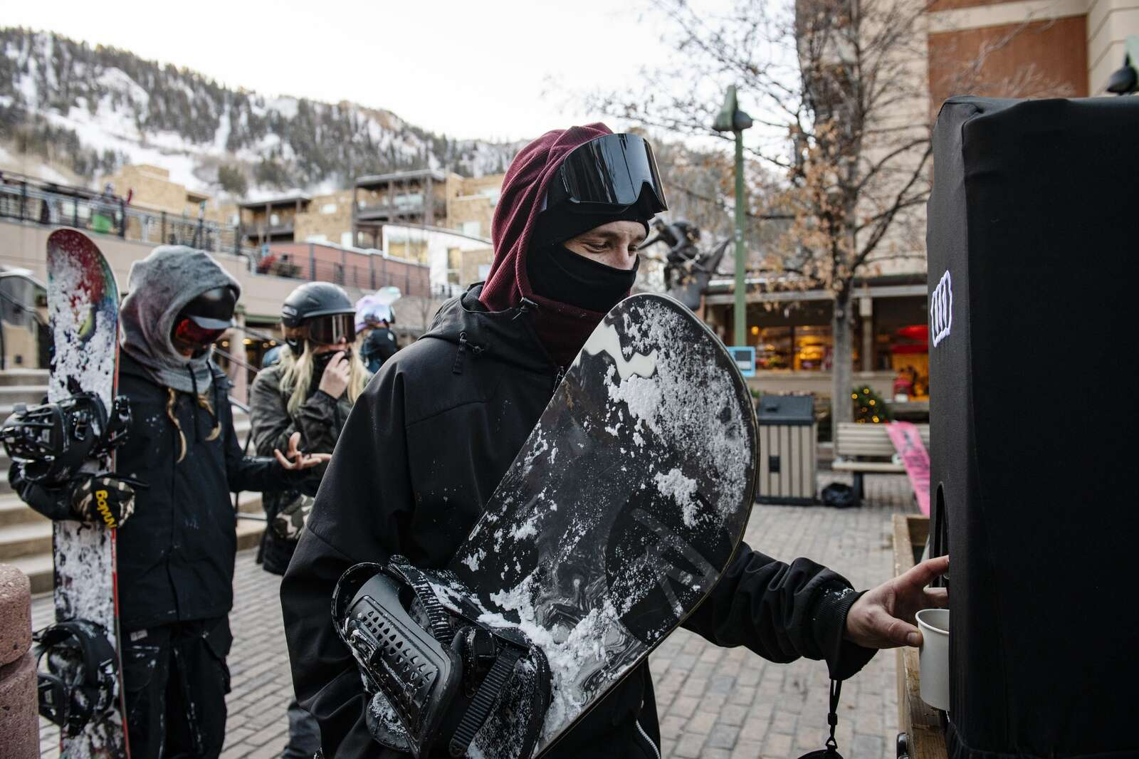 Aspen local Aaron Spada fills a cup with hot chocolate after getting off Aspen Mountain on Thursday, Dec. 3, 2020. Spada works as a bartender at Jimmys. (Kelsey Brunner/The Aspen Times)